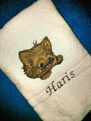 Embroidered towel with adorable kitty design