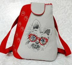 Embroidered backpack with little terrier design