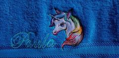Embroidered towel with rainbow unicorn design