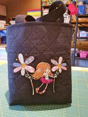 Embroidered bag wit girl with flowers design