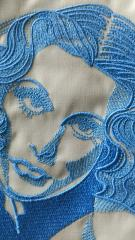 Face of woman with flower embroidery design