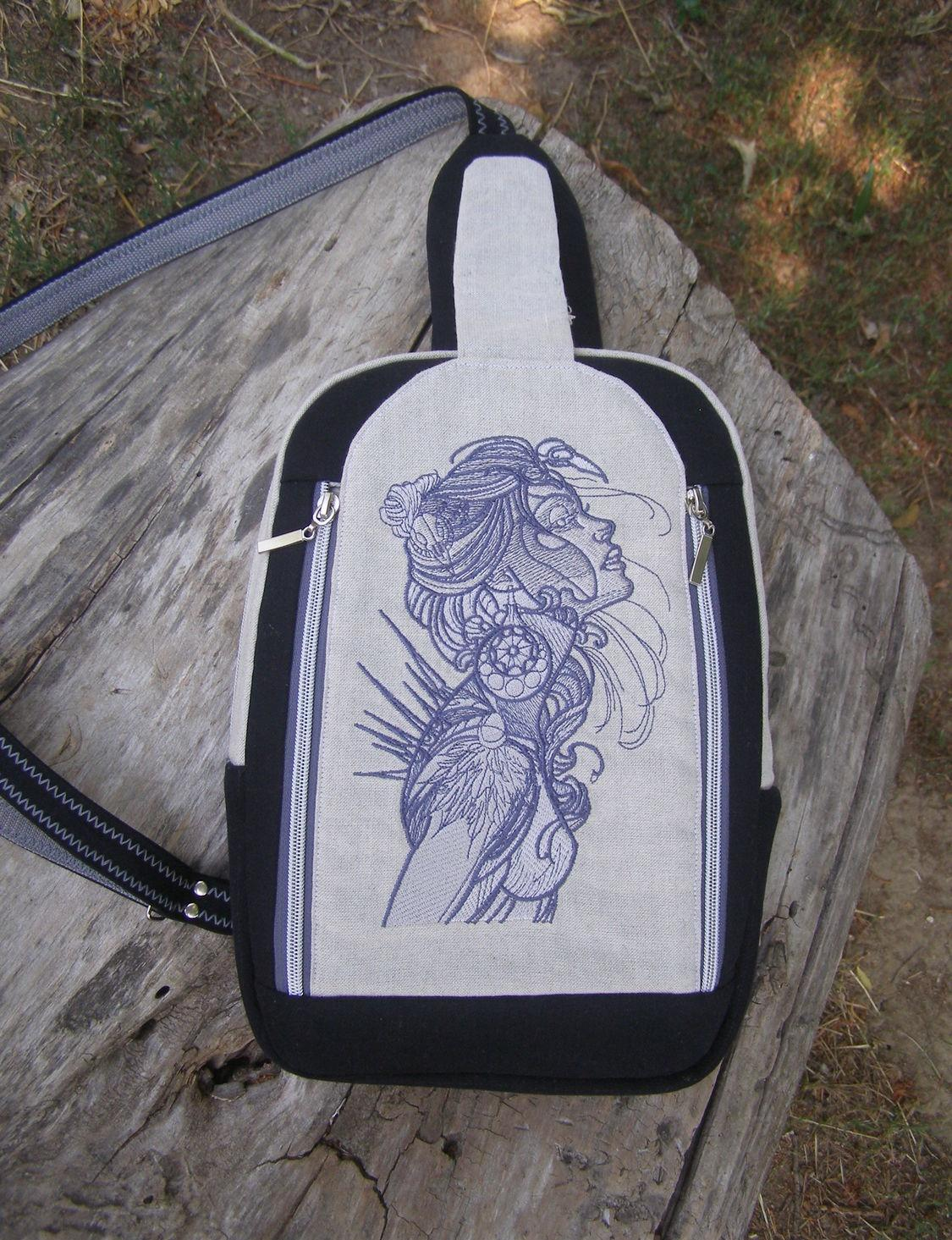 Embroidered backpack with exotic beauty design