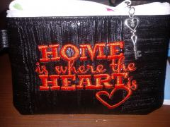 Embroidered handbag with Home is here heart free design