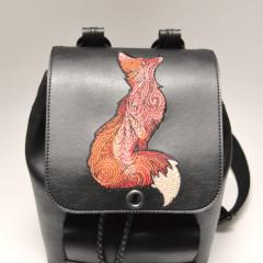 Cover of embroidered backpack with Fox looking sky design