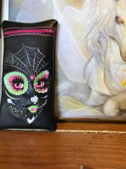 Embroidered handbag with skull makeup design