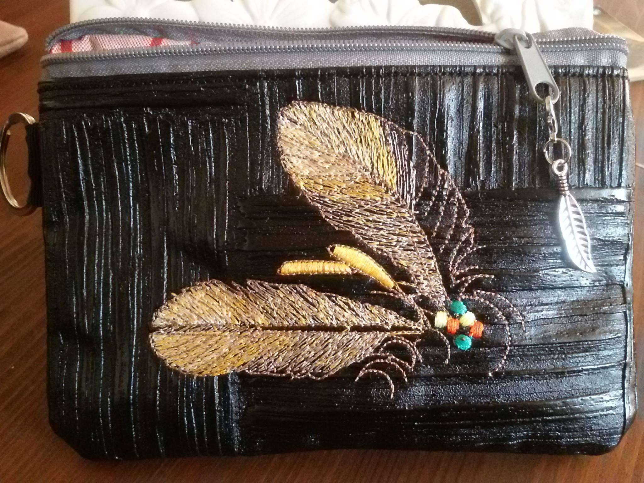 Embroidered handbag with Two feathers design.jpg