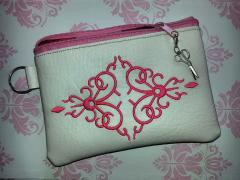 Embroidered handbag with Corner ornament design