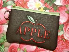 Embroidered handbag with Apple symbol design