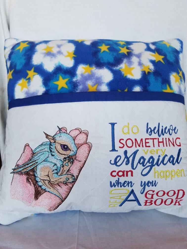 Embroidered cushion with Dragon in my hand design