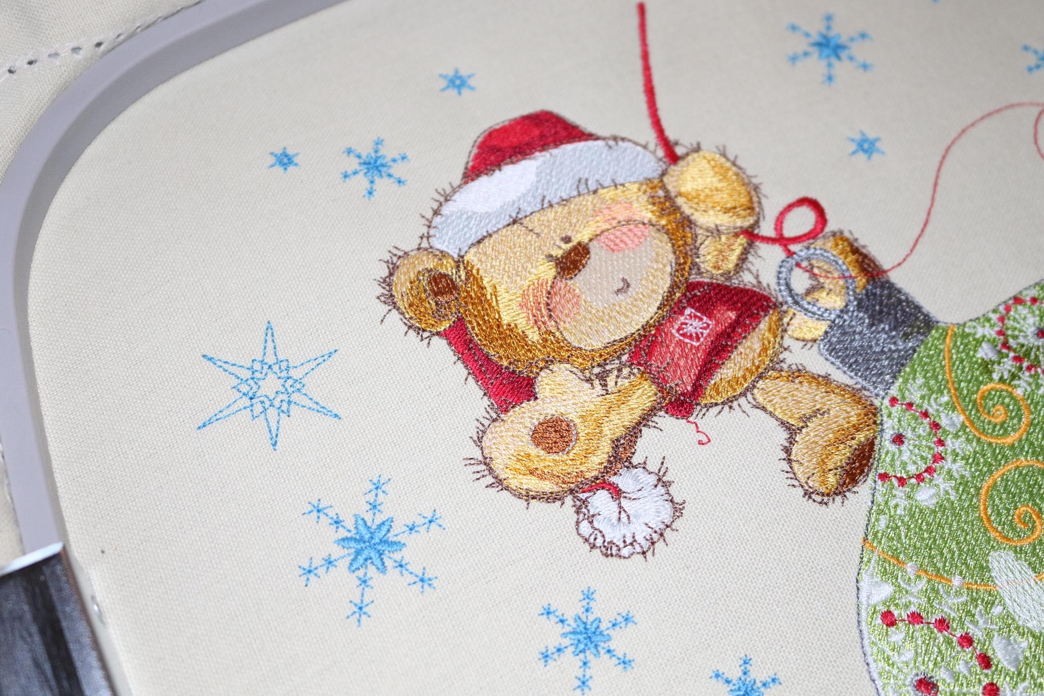 Teddy bear on Christmas ball design on hoop