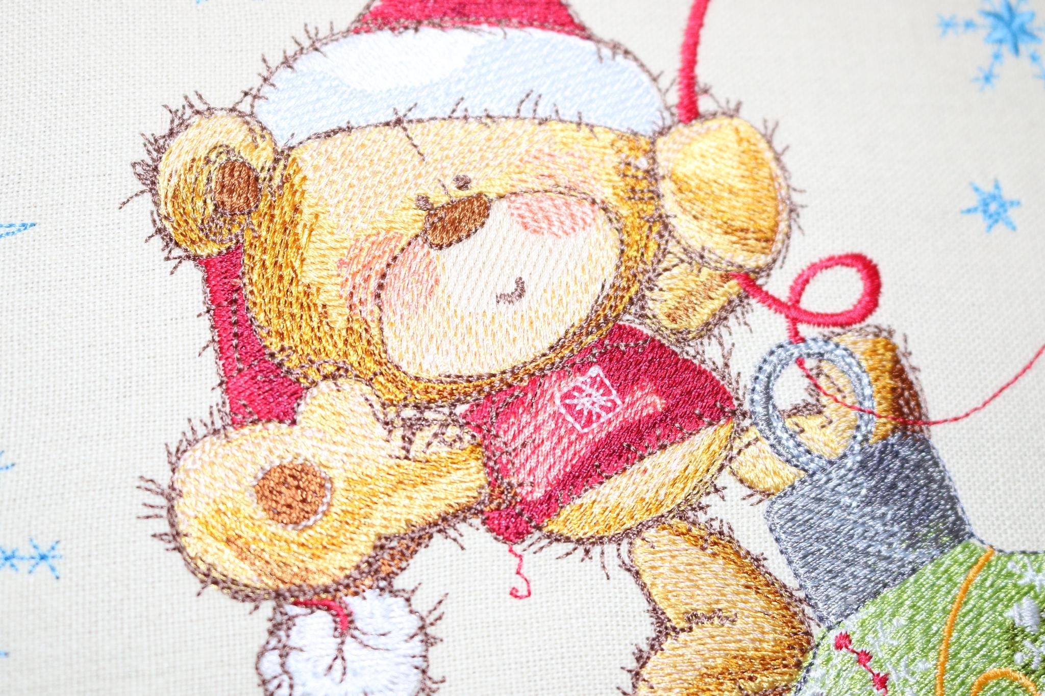 Teddy bear on Christmas ball embroidery design