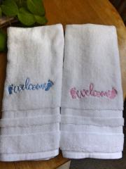 Set of embroidered towels with Welcome baby free design