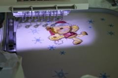 Teddy bear on Christmas ball design in work