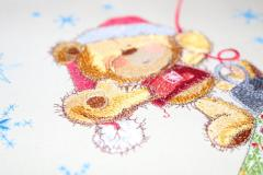 Work on Teddy bear on Christmas ball design