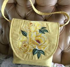 Embroidered bag with yellow roses