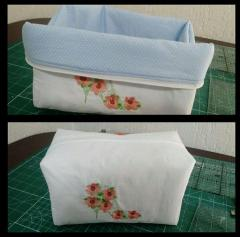 Embroidered cosmetic bag with flower design