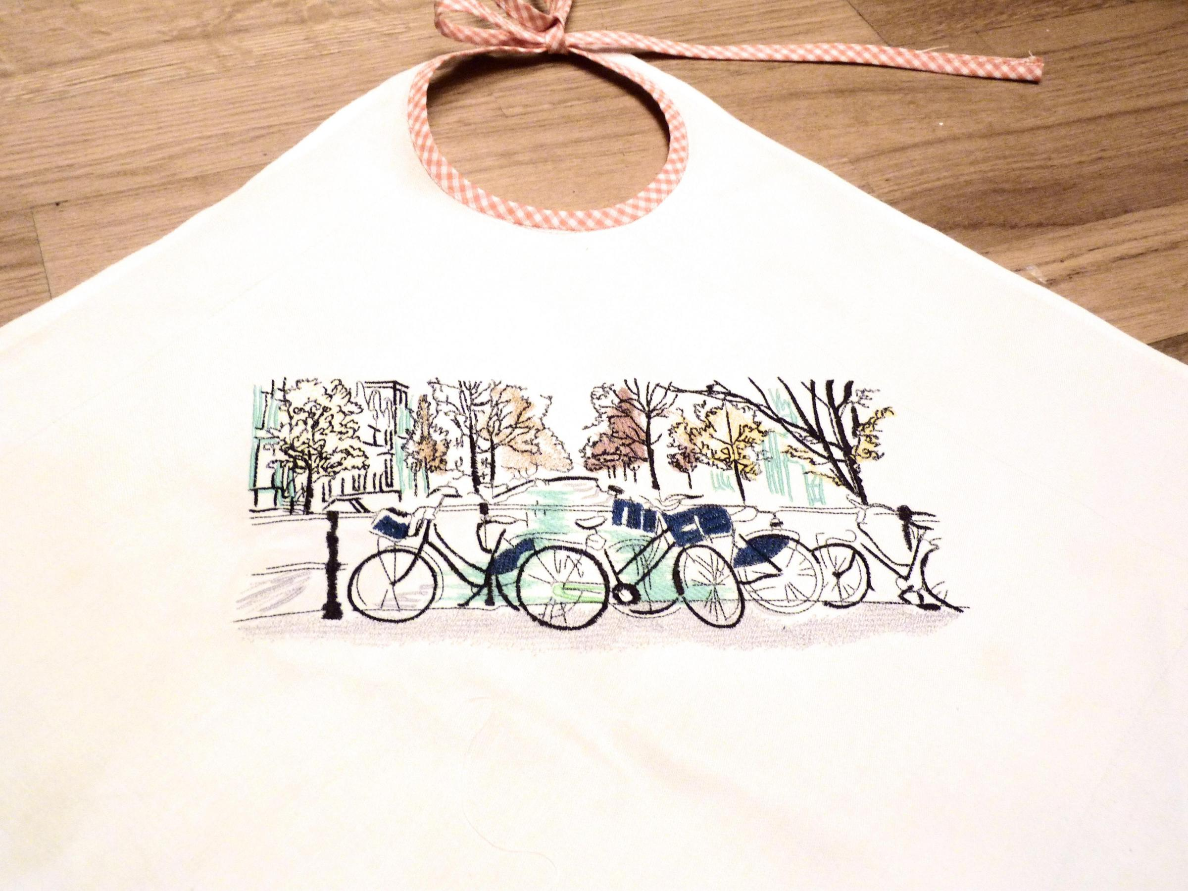 Fragment of embroidered bib with Bicycles design