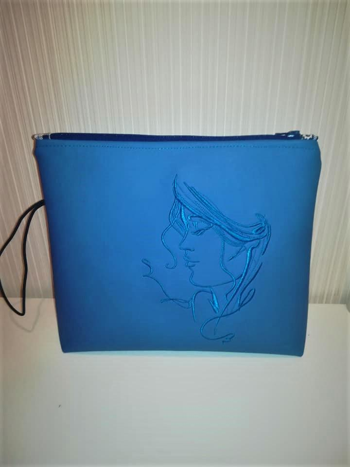 Embroidered handbag with Woman's portrait design