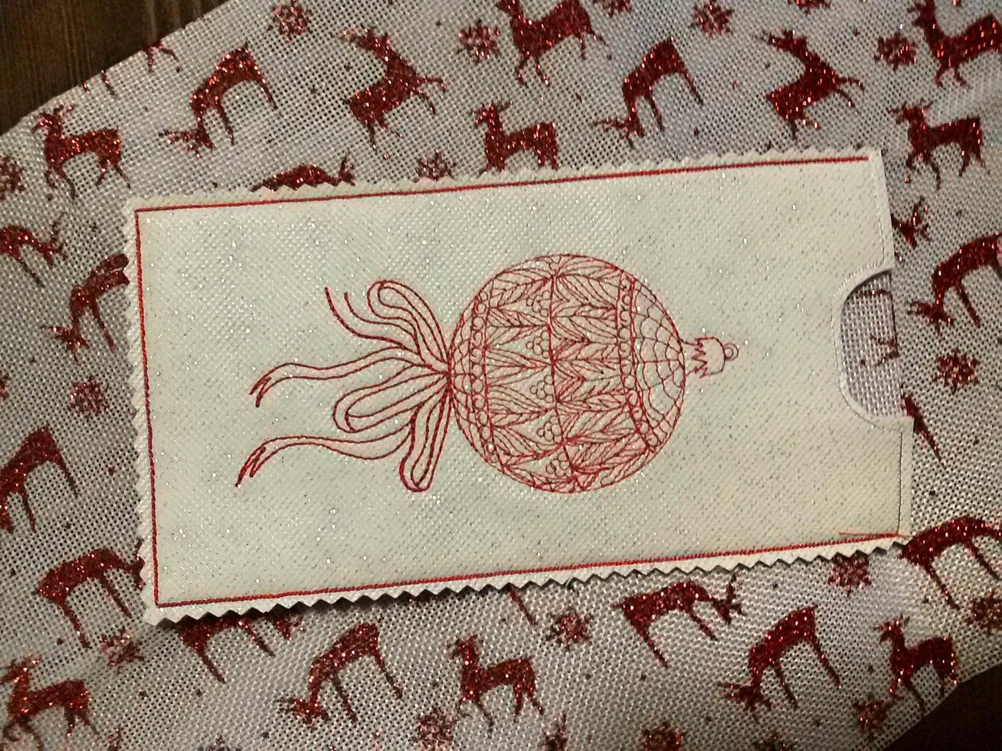 Embroidered case with Christmas ball free design