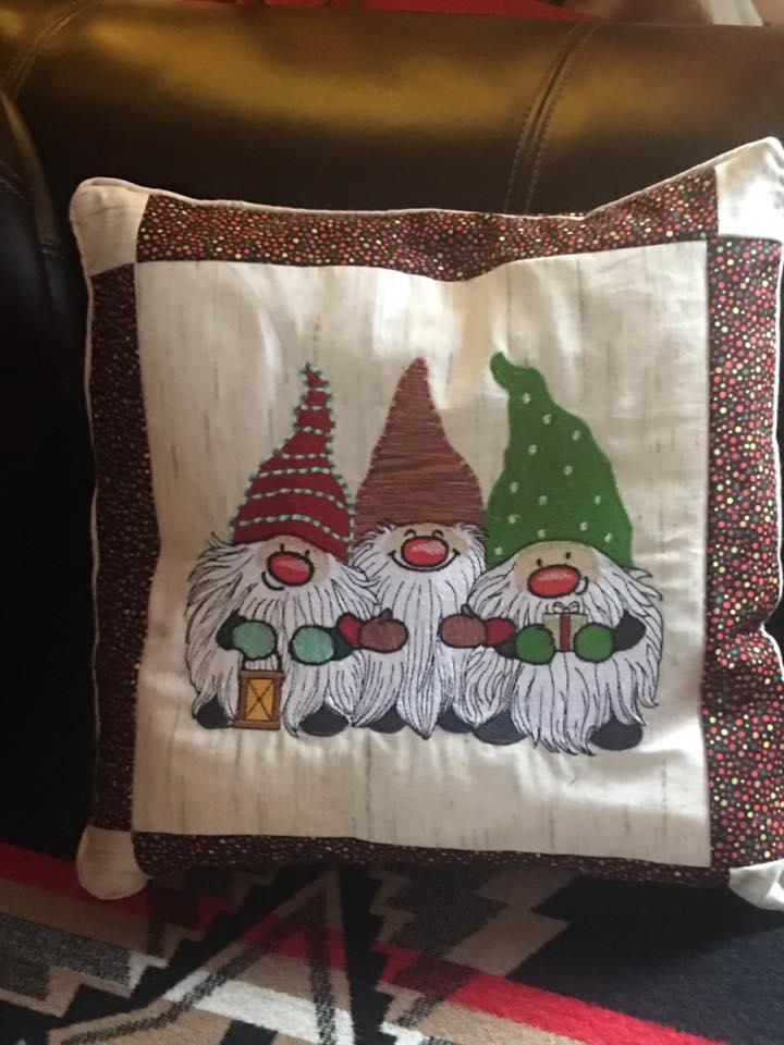Embroidered cushion with Three dwarves design