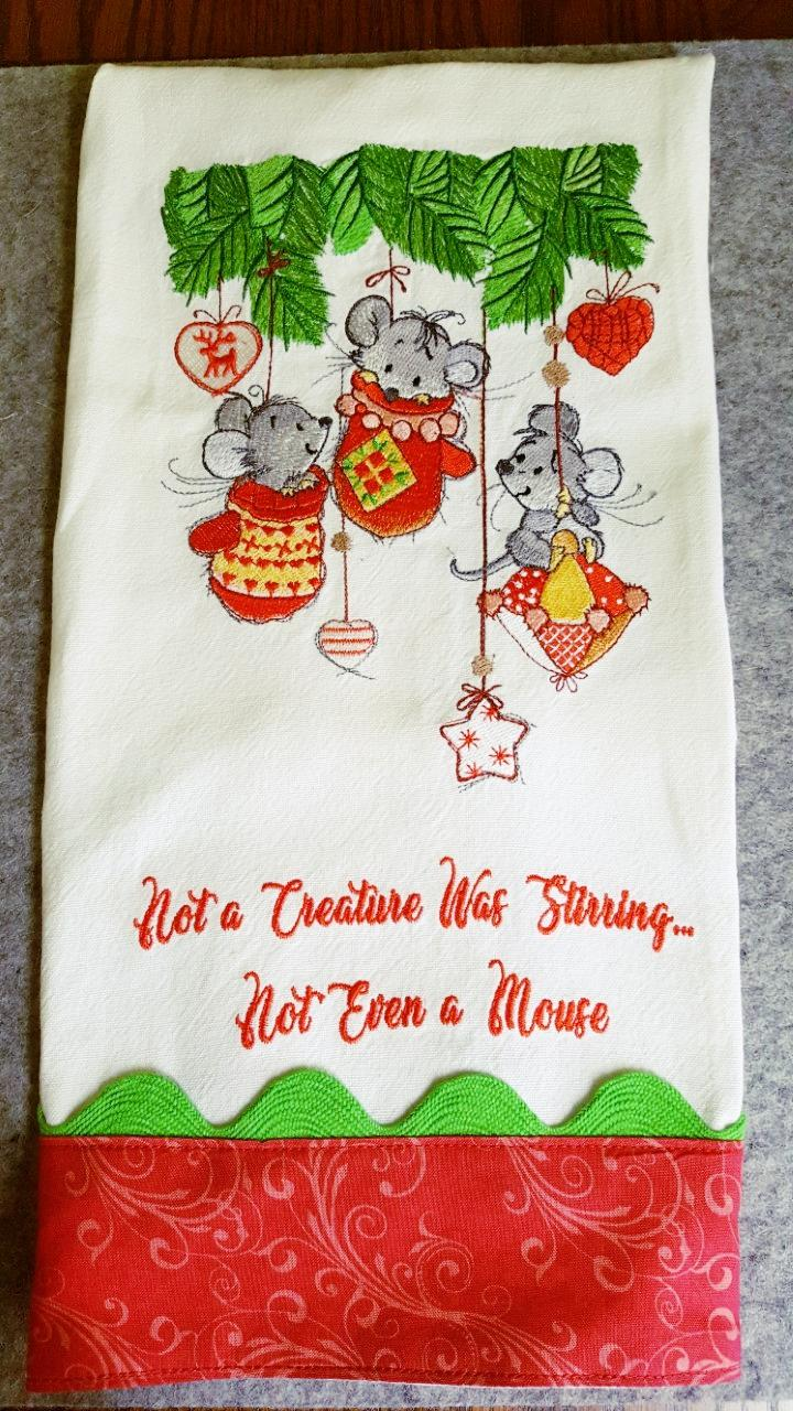 Embroidered napkin with Christmas mouses design
