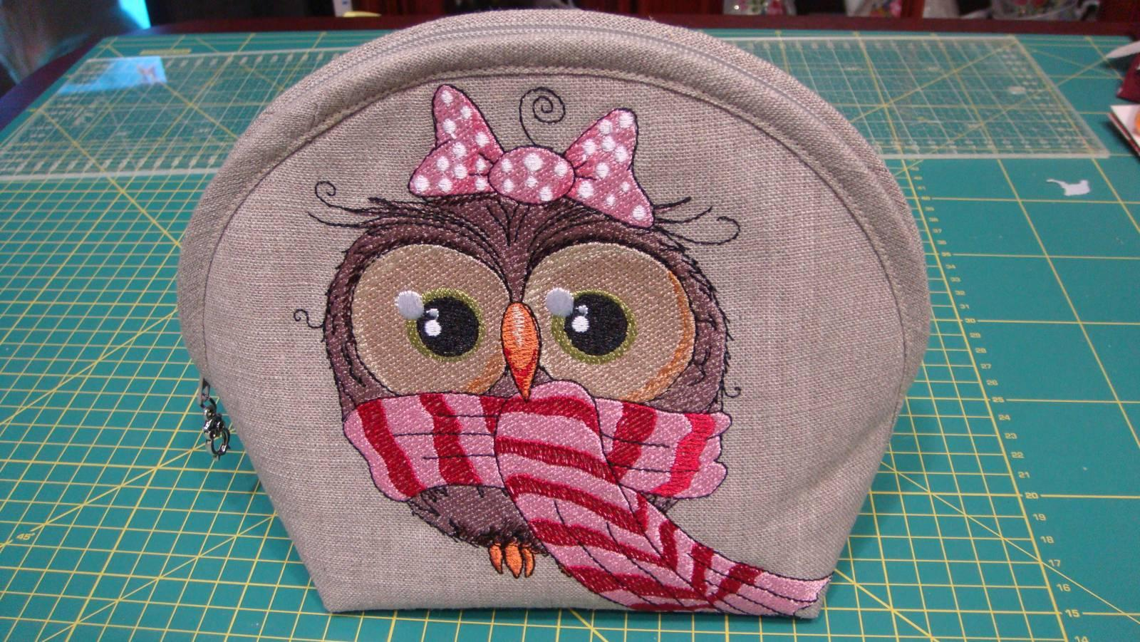 Cosmetic bag with owl scarf embroidery design