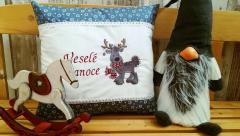Embroidered cushion with Christmas deer design