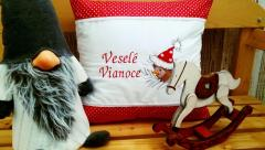 Embroidered cushion with Christmas bird design
