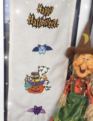 Embroidered curtain with Halloween design