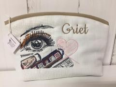 Embroidered handbag with Makeup design