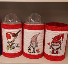 Embroidered textile boxes with Christmas designs