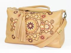 Embroidered bag with decoration free design