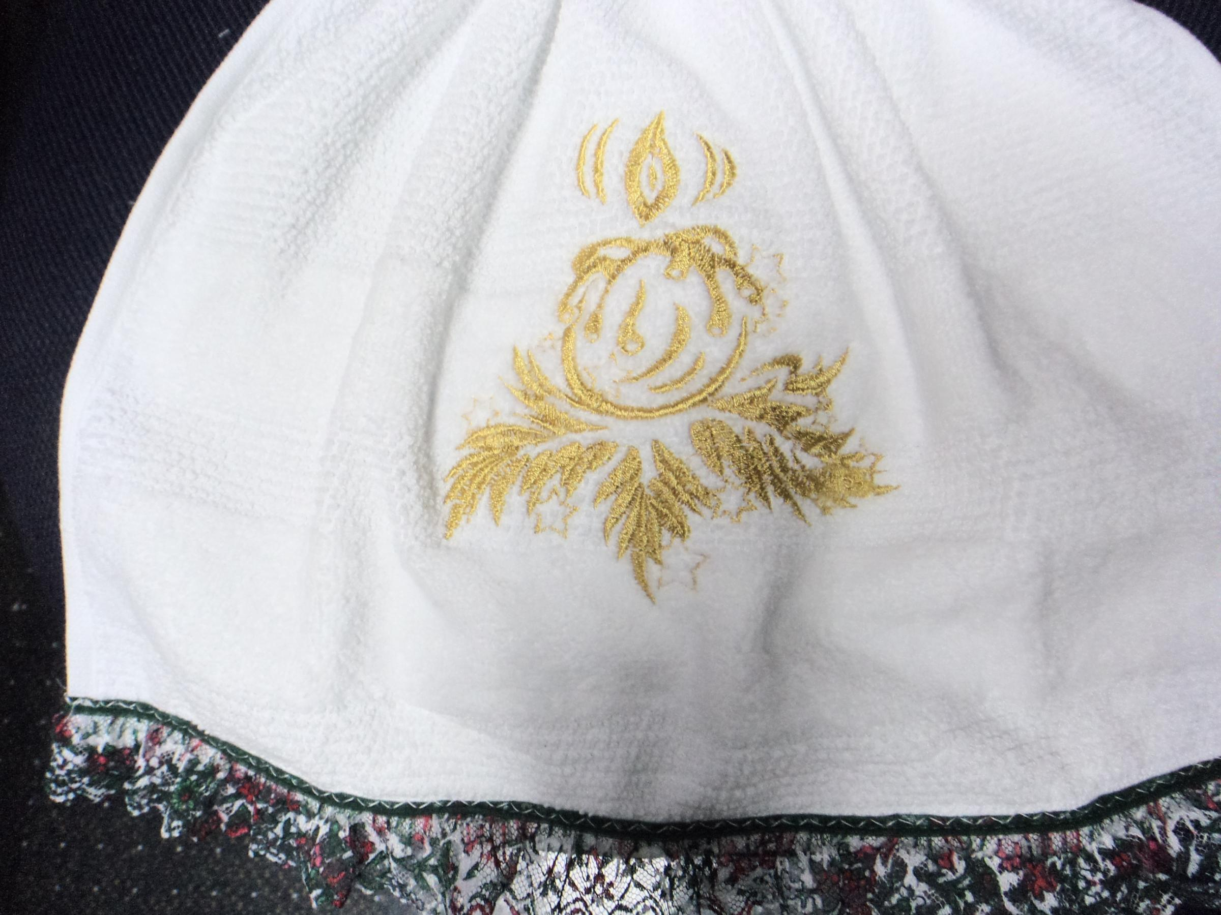 Fragment of embroidered skirt with Christmas candle design