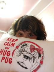Embroidered cushion with Pug dog design
