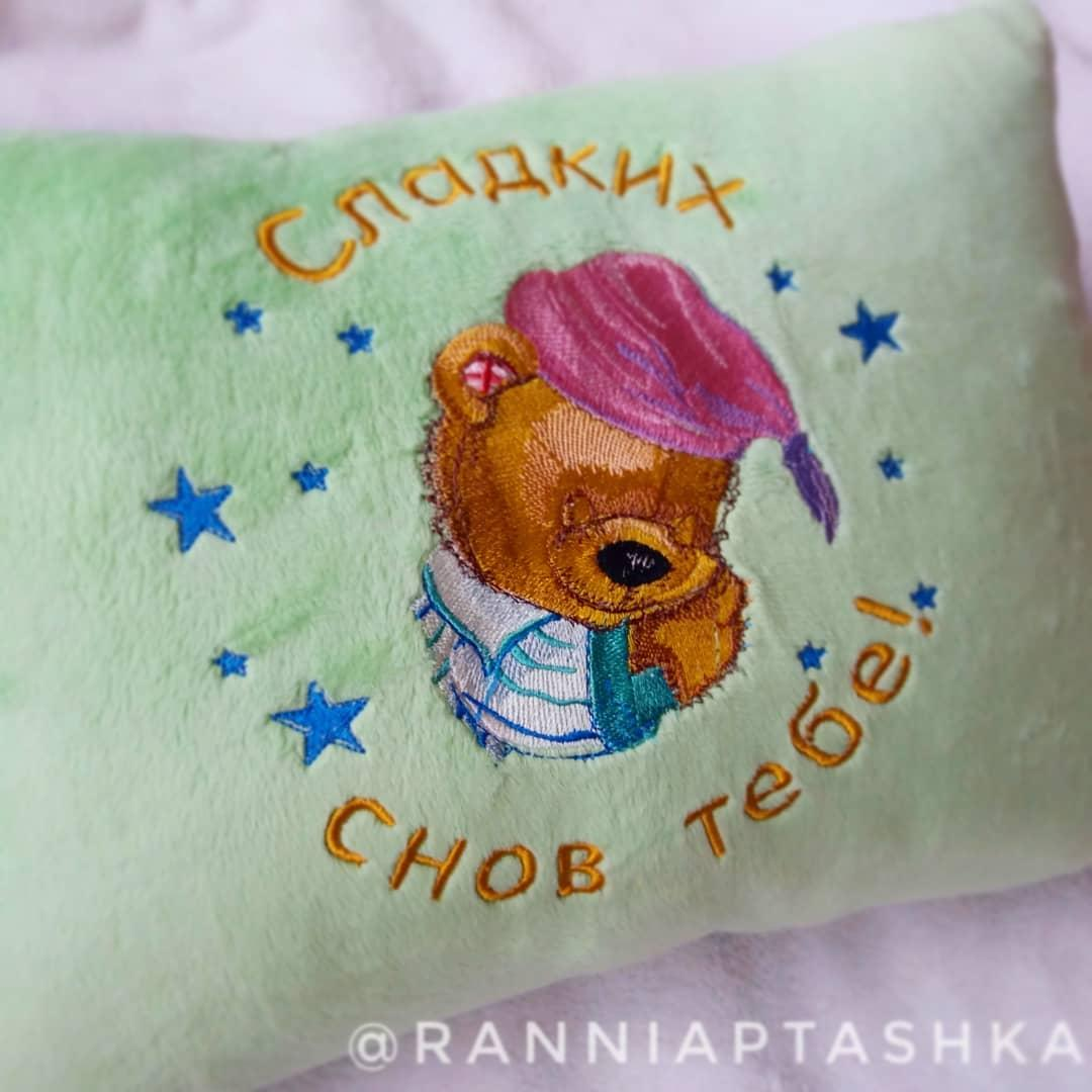 Embroidered cushion with Sleeping bear design