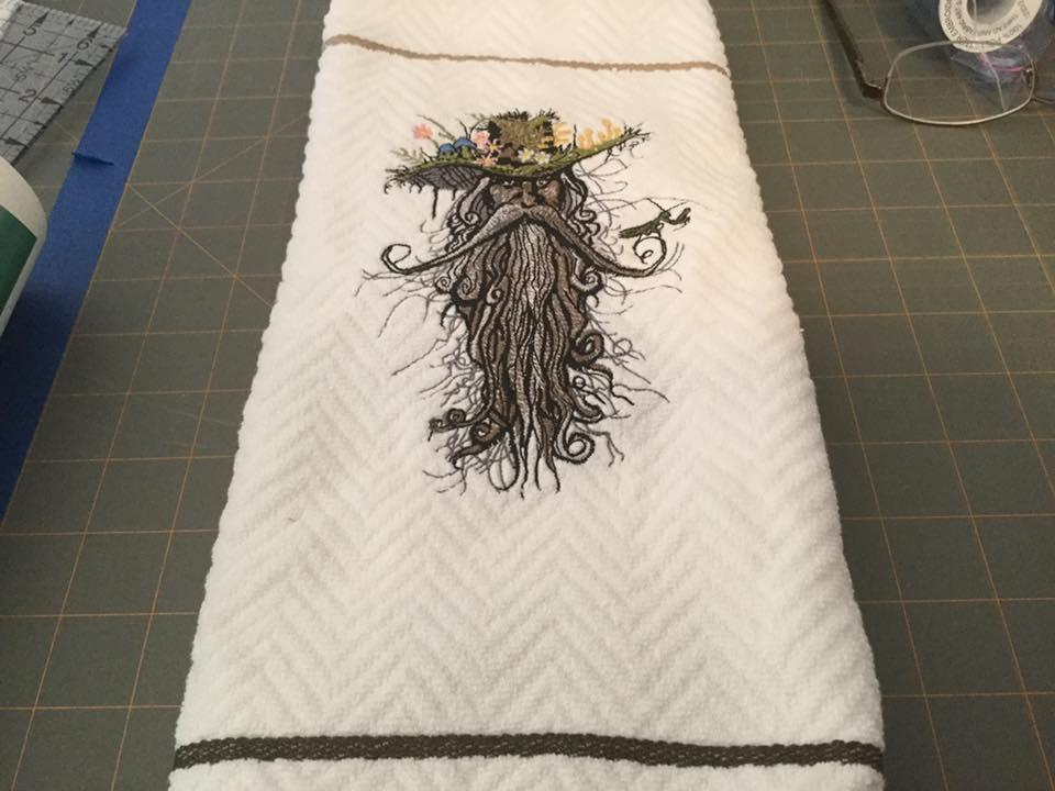 Embroidered towel with Root man design