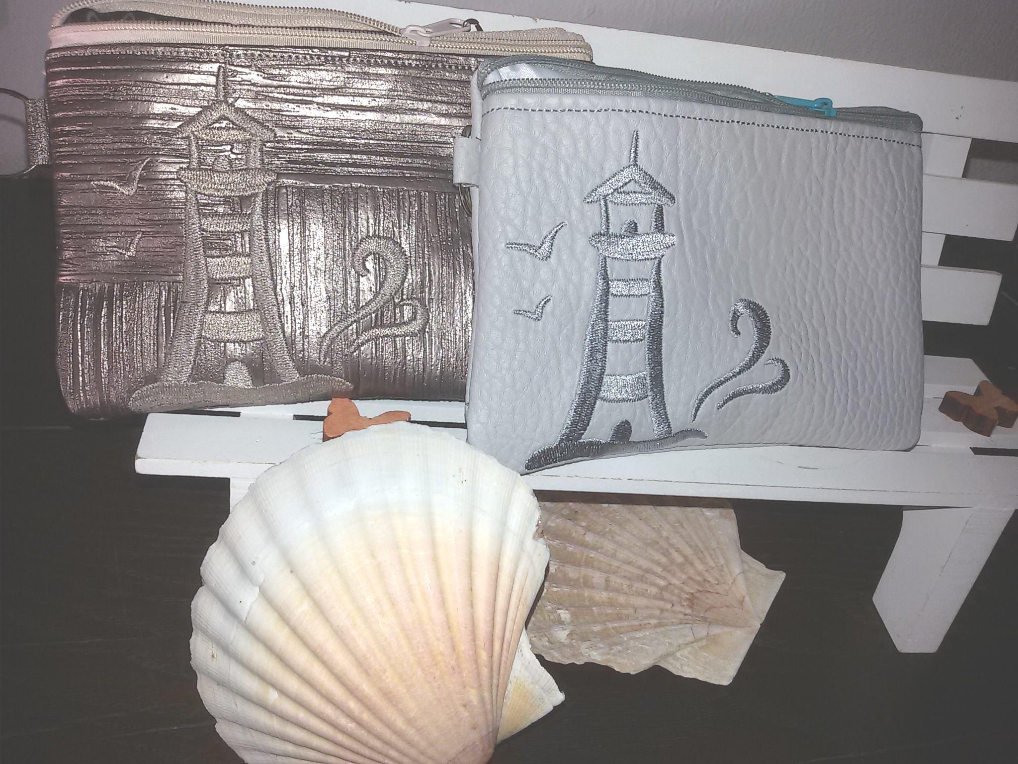 Two cosmetics bags with Lighthouse design
