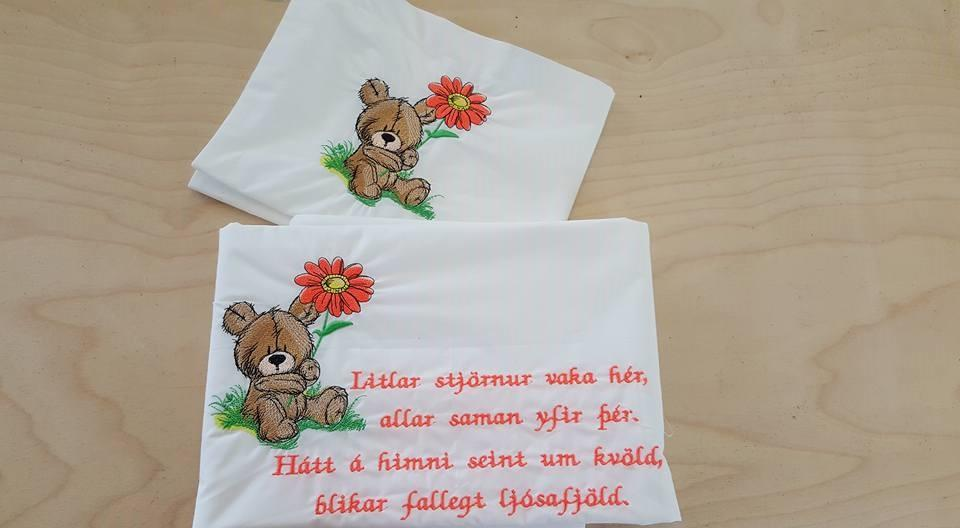 Embroidered postcard with Teddy bear and flower