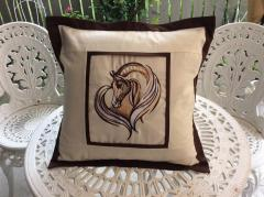 Decorative pillow with a sad horse machine embroidery design