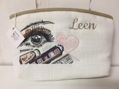 Embroidered cosmetics bag with Eye design
