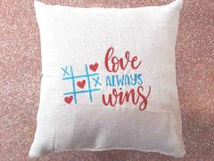 Embroidered cushion with Love always wins free design
