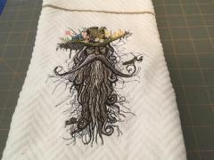 Embroidered towel with Rootman design