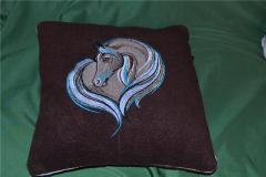 Pillow with a sad horse machine embroidery design