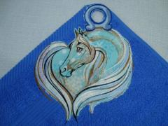 Towel with a sad horse machine embroidery design
