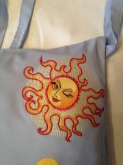 Tote bag with sun free embroidery design