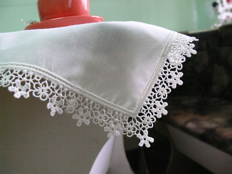 Finished embroidered napkins with lace