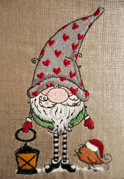 Gnome in cap with hearts embroidery design