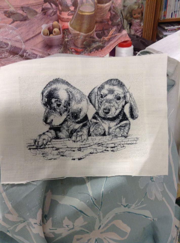 Piece of fabric with Pretty puppies free embroidery design