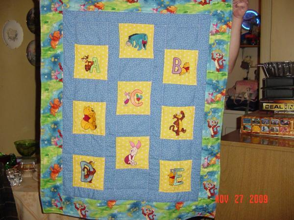 Quilt with Winnie Pooh free embroidery designs