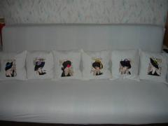 White pillows with ladies from different capitals: all together